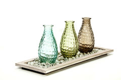 Three Decorative Glass Vases on Stand with Pebbles Stock Photo