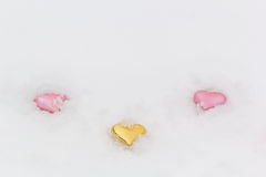 Three decorative hearts in the white snow Stock Photography