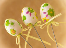 Three decorative painted easter eggs on sticks Stock Images