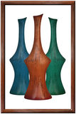 Three decorative vases in a wooden frame. Stock Images