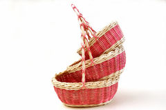 Three decorative wicker baskets of various sizes from vines on a Royalty Free Stock Photography