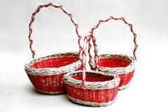 Three decorative wicker baskets of various sizes from vines on a Royalty Free Stock Image