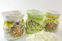 Three decoupage decorated flower pattern jar on white background Stock Image