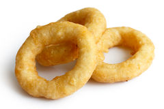 Three deep fried onion or calamari rings  on white. Royalty Free Stock Photo