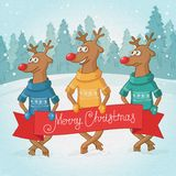 Three deer on the background. Winter forest landscape. Postcard Merry Christmas. Royalty Free Stock Photo