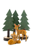 Three deer toys with wooden pine trees Royalty Free Stock Images