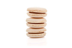 Three delicious beige colored macaroons isolated. On white background Royalty Free Stock Photos