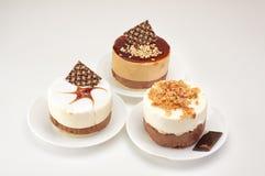Three delicious cakes isolated Royalty Free Stock Photos