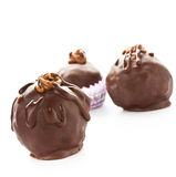 Three delicious  dark chocolate candies on a white back Royalty Free Stock Photography