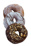Three delicious donuts side by side on white stock photography