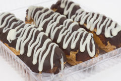 Three delicious eclair covered with chocolate icing Stock Photography