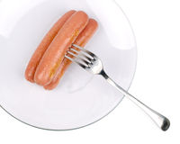 Three delicious frankfurters on a white plate Stock Images