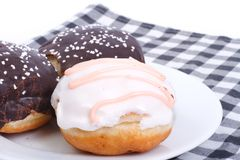 Three delicious fresh donuts in the glaze Royalty Free Stock Image