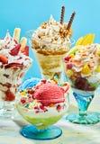 Three delicious ice cream sundaes on table Stock Image