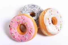 Three delicious and tempting donuts with different flavour donuts and toppings sugar sweet addiction concept Stock Photography