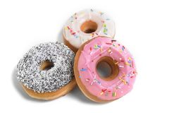 Three delicious and tempting donuts with different flavour donuts and toppings sugar sweet addiction concept Stock Image