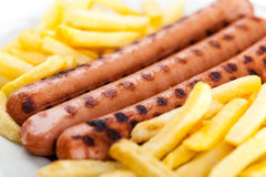 Wurstel with chips Royalty Free Stock Images