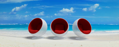 Three designer seats at the beach Royalty Free Stock Image