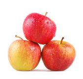 Three dewy apples on a white background Stock Images