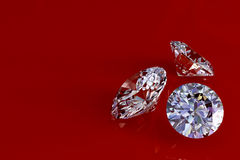 Three diamonds on red glossy background Royalty Free Stock Photography