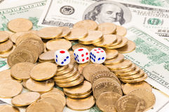 Three dice. Coins and dollars Stock Images