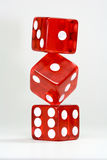 Three dice. Three stacked dice on white Stock Photo