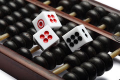 Three dice on abacus are symbolic of gambling Royalty Free Stock Image