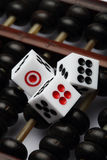 Three dice on abacus are symbolic of gambling Royalty Free Stock Photos