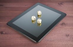 Three dice on digital tablet pc, texas game online Royalty Free Stock Photo