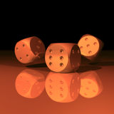 Three dice falling. 3 rendered dice on a reflecting floor. Image has DOF, focus is on front dice Royalty Free Stock Photography