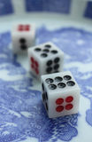 Three dice. Gambler will to take dice to gamble in casinos Stock Photos
