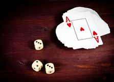 Three dice near playing card, poker game texas Stock Photography