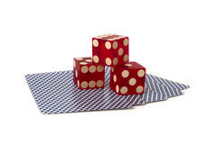 Three dice on playing cards Stock Photos