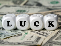 Three dice spelling LUCK Stock Images