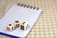Three dices with notepad. For business concept Royalty Free Stock Image