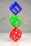 Three dices. Red, green and blue dices one on another on the shining plane, 3d rendering Stock Photography