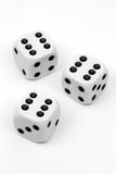 Three dices on white. Background Stock Images