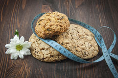 Three dietary biscuits and homemade cakes. And meter on brown wooden surface stock photos