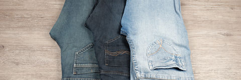 Three different blue jeans royalty free stock photography