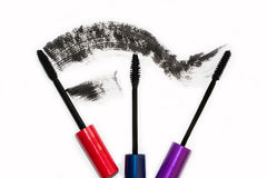 Three different brushes of black mascara for eyelashes Royalty Free Stock Photo