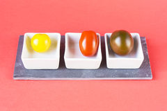 Three different cherry tomatoes Stock Images