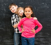 Three different children stand one by one peeking out from behind each other Royalty Free Stock Photos