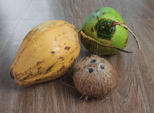 Three different coconuts on table. Horizontal view Stock Photo
