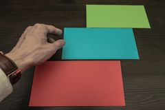 Three different colored envelopes. The process of choosing. stock images