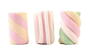 Three different colorful marshmallow. Close up. Royalty Free Stock Image