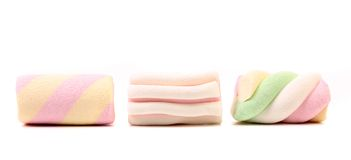 Three different colorful marshmallow. Close up. Stock Image
