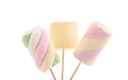 Three different colorful marshmallow on sticks. Royalty Free Stock Photo