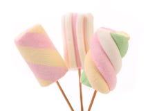 Three different colorful marshmallow on sticks. Stock Photo