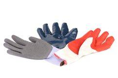 Three different colors protective gloves. Royalty Free Stock Image