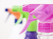 Three different colors sprayers closeup Stock Photography